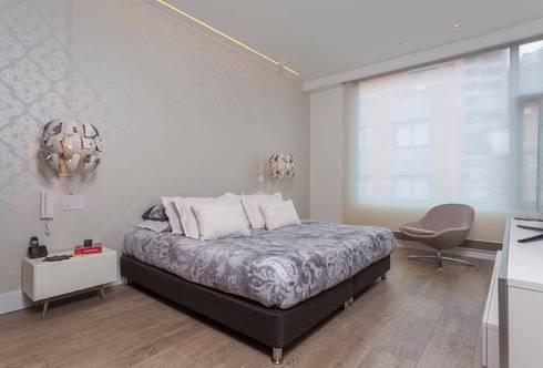 Apto Cr 2 – Cll 69: Habitaciones de estilo moderno por Bloque B Arquitectos