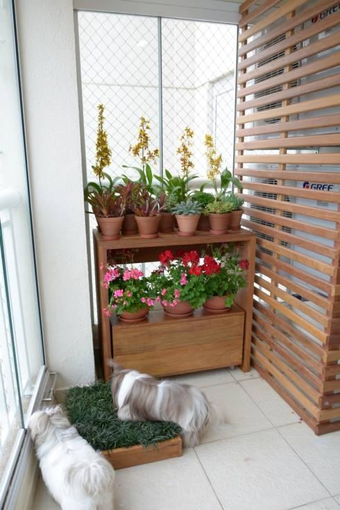 Hiên, sân thượng by Eduardo Luppi Paisagismo Ltda.