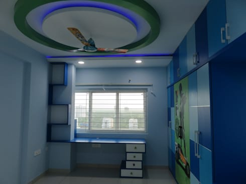 false ceiling & study table: modern Bedroom by Bluebell Interiors