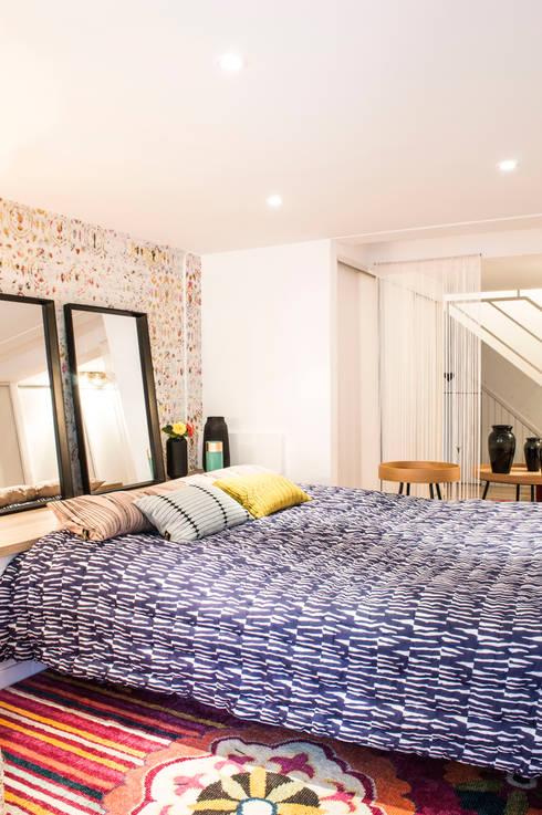 Rénovation compléte d'un sous sol de 70M2 - Partie 1 dressing & chambre d'amis: Chambre de style  par COLOMBE MARCIANO