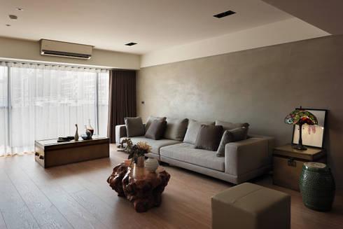 光復大廈:  客廳 by AIRS 艾兒斯國際室內裝修有限公司