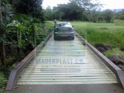 Fabricación de Cerramientos para zonas ecológicas: Paredes y suelos de estilo  por Maderplast S.A.