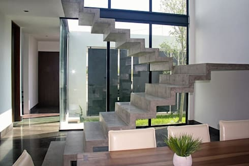Escalera concreto: Pasillos y recibidores de estilo  por Narda Davila arquitectura