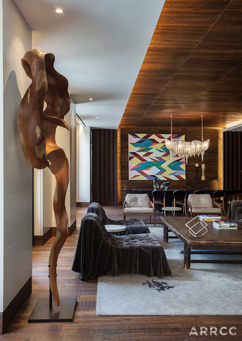 Barcelona Apartment: eclectic Living room by ARRCC