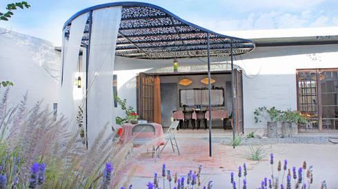 Casa Clemente - Juan Carlos Loyo Arquitectura: Casas de estilo moderno por Juan Carlos Loyo Arquitectura