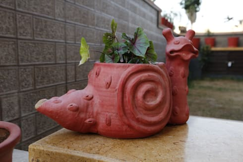 Landscaping : modern Garden by RAVI - NUPUR ARCHITECTS