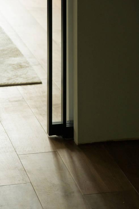 Pocket Sliding Door: modern Bedroom by Sensearchitects Limited