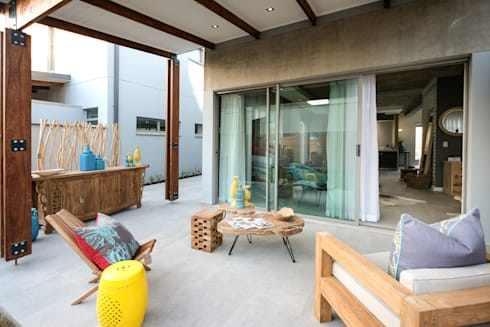 The Sheds Waterfall Estate, Midrand:  Balconies, verandas & terraces  by Melonwoods Indonesian Furniture