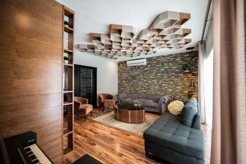 industrial Living room by ESTUDIO TANGUMA