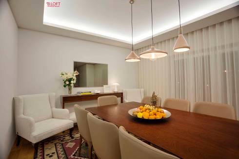 Pormenor decoração sala de jantar: Salas de jantar modernas por B.loft