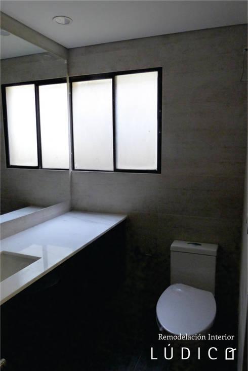 Apartamento Ciudad Salitre – Bogotá: Baños de estilo minimalista por Lúdico Arquitectos