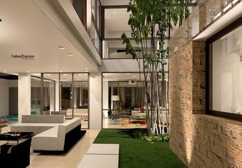 CASA T C: Salas de estilo moderno por Cabas/Garzon Arquitectos