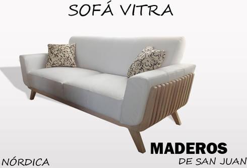 Sofá vitra: Hogar de estilo  por Maderos de san juan