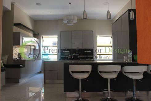 House T:   by Première Interior Designs