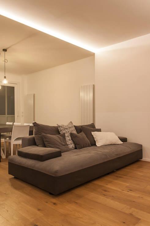 Salon de style de style Minimaliste par Architettura & Interior Design 'Officina Archetipo'