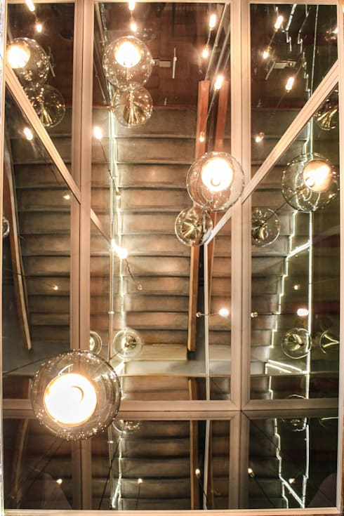 LA BELLE: Bares y discotecas de estilo  por santiago dussan architecture & Interior design