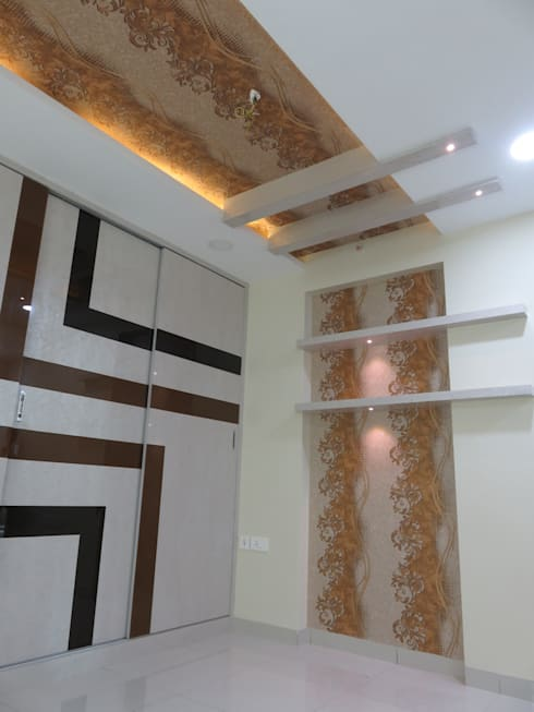 false ceiling & bed backdrop in guest bedroom:  Bedroom by Bluebell Interiors