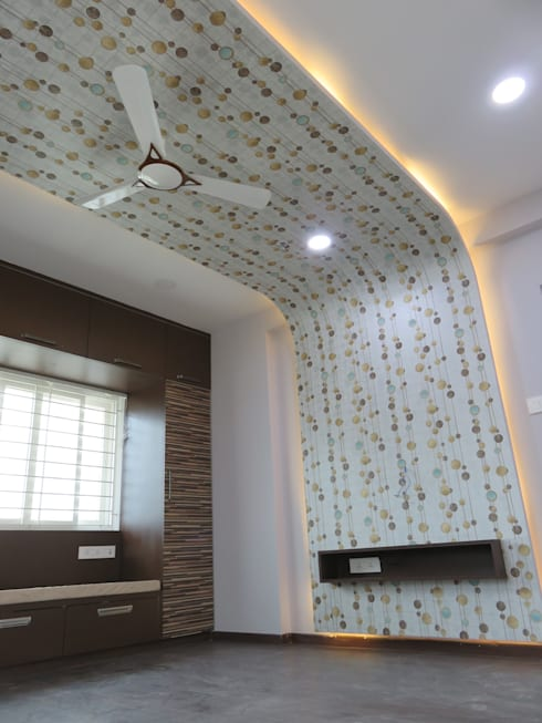 ceiling & LCD panel in master bedroom:  Bedroom by Bluebell Interiors