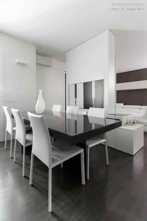 Interni di design loft moderno arredato su misura con - Zona pranzo design ...