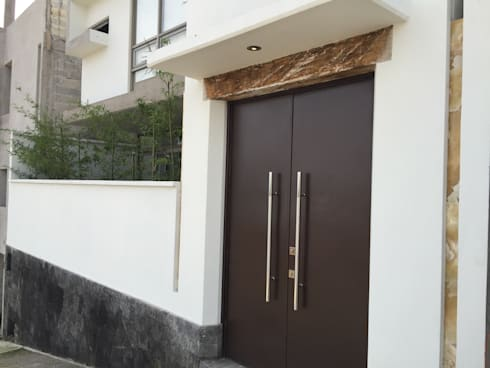 Detalle Fachada Posterior: Casas de estilo moderno por Cahtal Arquitectos
