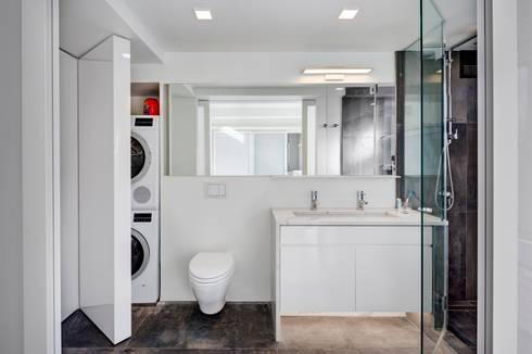 Master Bathroom with Laundry Closet: modern Bathroom by Lilian H. Weinreich Architects