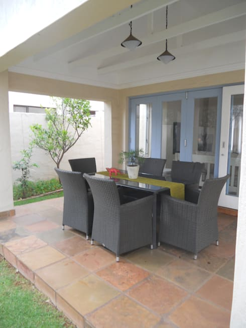 French House:  Patios by SOJE Interior, Design and Decor PTY (Ltd)
