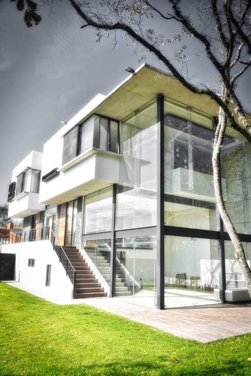 Casas de estilo  por ArqCubo