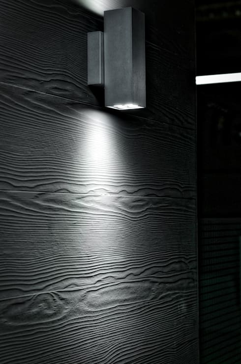 Detalle de iluminación en muros: Paredes y pisos de estilo moderno por ArqCubo
