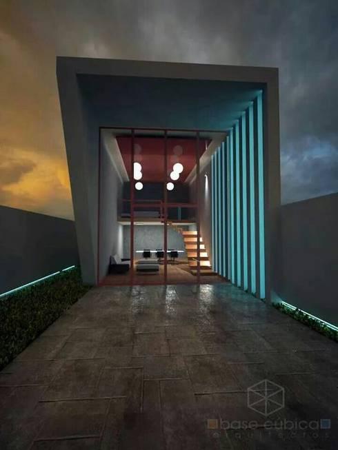 fachada: Estudios y oficinas de estilo moderno por Base cubica Arquitectos
