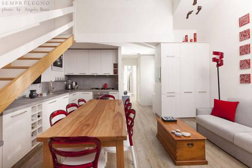 Arredamenti di design realizzati su misura per un open for Mobiletto angolare soggiorno