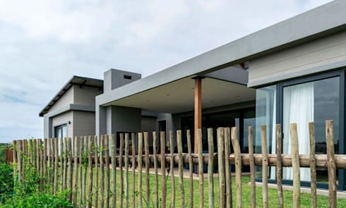 Modern family home in the heart of Simbithi Eco Estate:  Patios by CA Architects