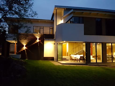 evening glow: modern Houses by Human Voice Architects