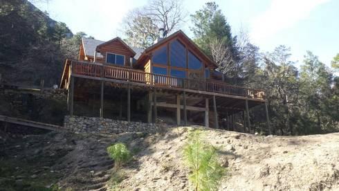 Cabaña Elite I: Casas de estilo rural por nuk arquitech