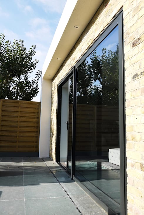 Contemporary house extension:  Windows  by Artform Architects
