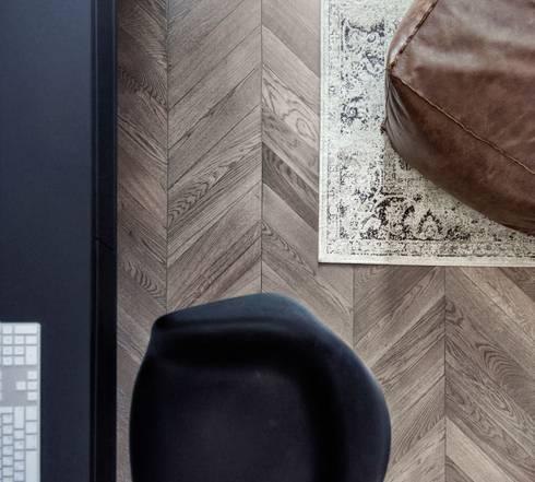 Estudios y oficinas de estilo minimalista por INT2architecture