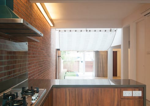 Terrace House at Robin Road: asian Kitchen by Quen Architects