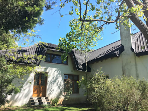 Thatch roof converted to tiles: modern Houses by Cintsa Thatching & Roofing