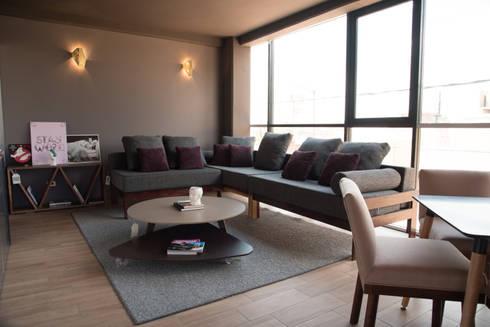 Departamento muestra Torre de Piedra : Salas de estilo moderno por DODA Arquitectura + Diseño