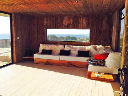 Casa Pangal: Livings de estilo rústico por Nido Arquitectos