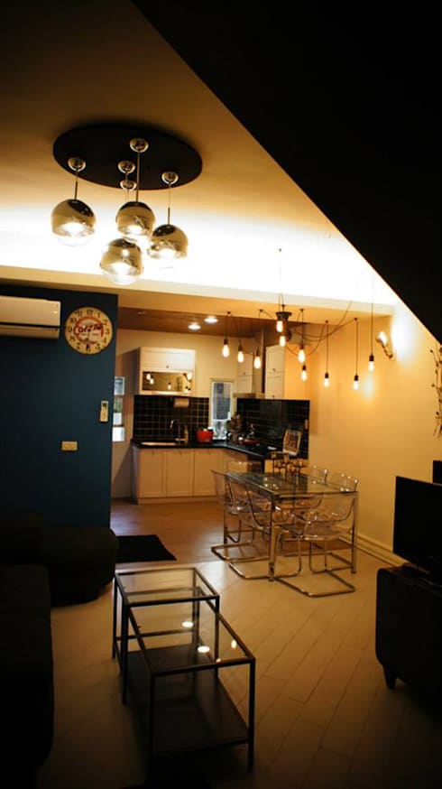 紋身師的家:  廚房 by 七輪空間設計