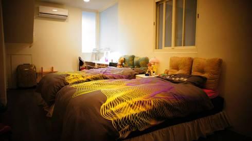 紋身師的家:  臥室 by 七輪空間設計