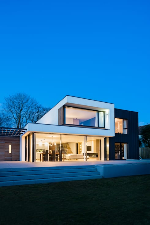 White Oaks Exterior at Night:  Houses by Barc Architects