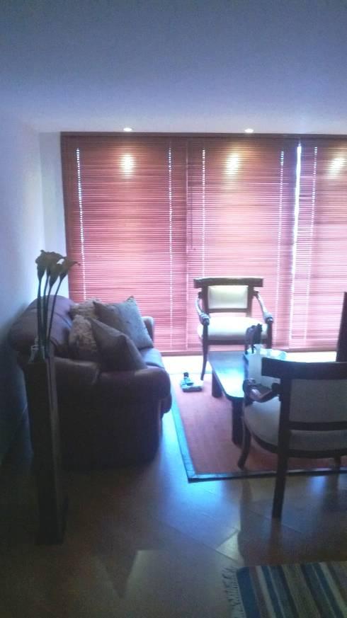 PROYECTO APARTAMENTO CALLE 151: Salas de estilo moderno por bdl concept/studio