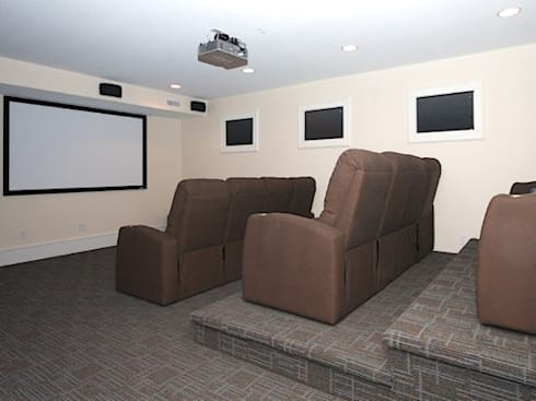 Private home theatre: modern Media room by Outer Banks Renovation & Construction