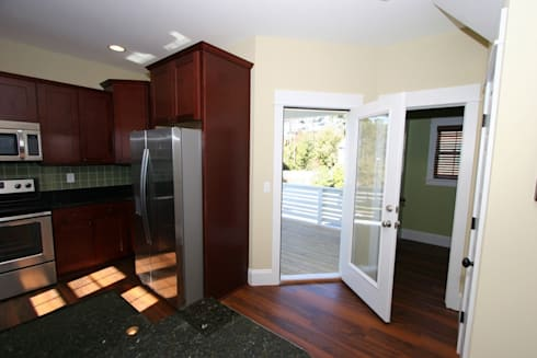 Access to the varanda: modern Kitchen by Outer Banks Renovation & Construction