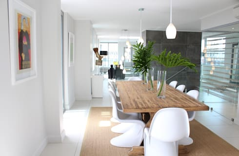 Apex Building—Penthouse: modern Dining room by House of Gargoyle