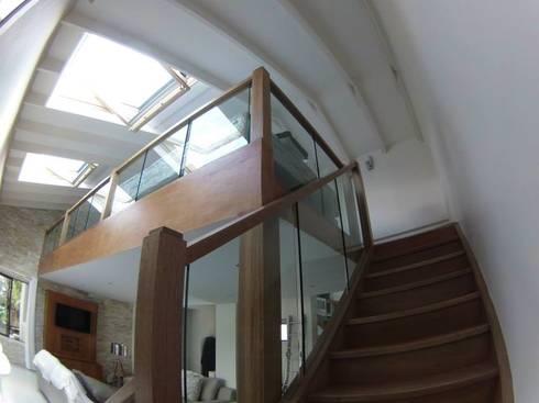 Mezzanine floor, staircase and balustrade: modern Bathroom by Loftspace