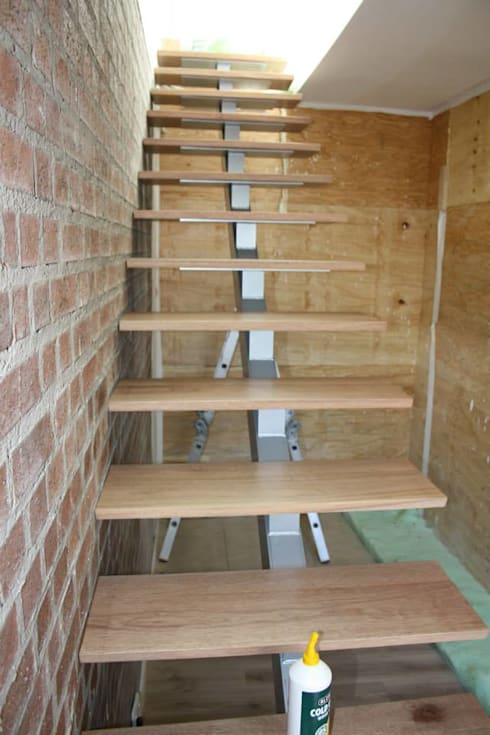 Loft room , staircase and Velux roof windows:  Corridor & hallway by Loftspace