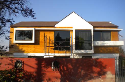 Vista exterior: Casas de estilo moderno por DIMA Arquitectura y Construcción