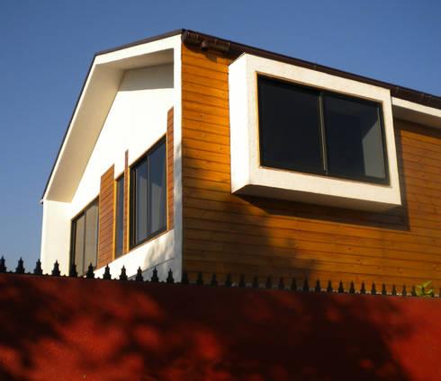 Vista exterior-Detalle de bo-window: Casas de estilo moderno por DIMA Arquitectura y Construcción